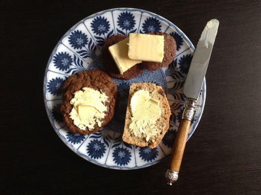 Beer bread, ginger snaps and chocolate biscuits with cheese on top, all on a pretty antique plate